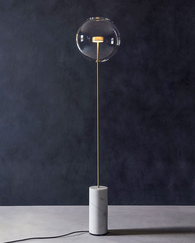 The lightness of our Soffio's sphere opposed to the solid marble base stands out from this dark blue wall. . . .
